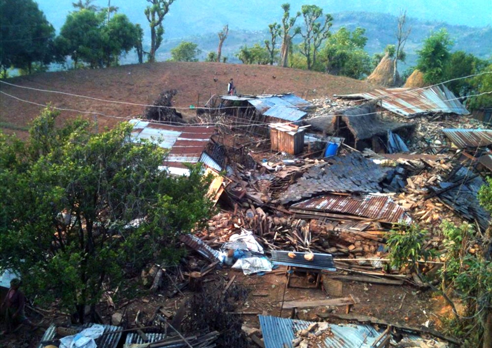 In this photo provided by World Vision, houses lie destroyed at Paslang village in Gorkha municipality, Nepal, Monday, April 27, 2015.