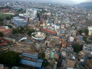 This aerial photo provided by Shreejan Bhandari, shows the historical Dharahara Tower, a city landmark, destroyed by Saturday's earthquake in Kathmandu, Nepal, Monday, April 27, 2015.