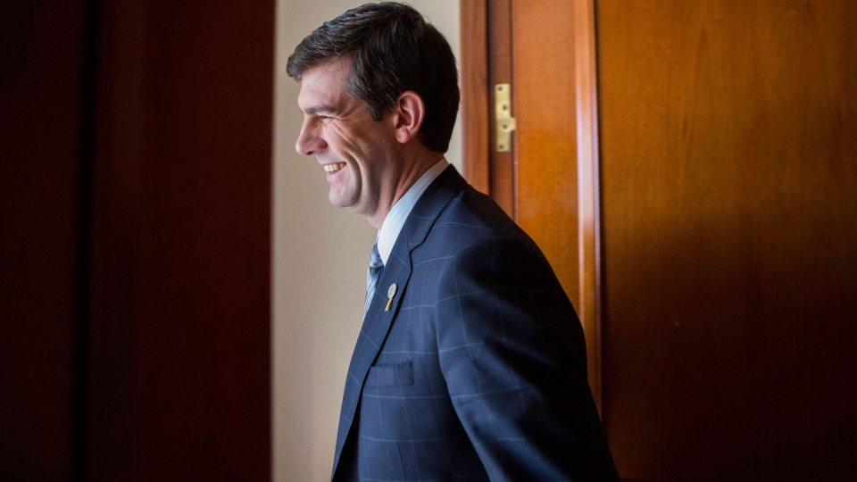 Edmonton Mayor Don Iveson returns to a session as he attends the Big Cities summit hosted by the Federation of Canadian Municipalities in Toronto on Thursday February 5 2015 .(Chris Young / THE CANADIAN PRESS)