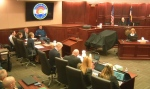 Judge Carlos A. Samour Jr., top right, presides over the opening of the trial of Colorado theater shooter James Holmes, far left, in Centennial, Colo., on Monday, April 27, 2015. The trial will determine if he'll be executed, spend his life in prison, or be committed to an institution as criminally insane. (Colorado Judicial Department via AP)