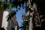A Greek flag is seen on a balcony in the tourist district of Plaka in Athens on Monday, April 27, 2015. (AP / Yorgos Karahalis)