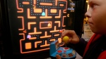 A youth tries a Ms. Pac-Man TV game in New York on Oct. 5, 2004. (AP / Richard Drew)