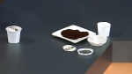Ingredients from a Keurig K-Cup are shown in their separate parts after they've been broken down by a Podcycle on CTV's Canada AM Tuesday, Apr. 28, 2015.