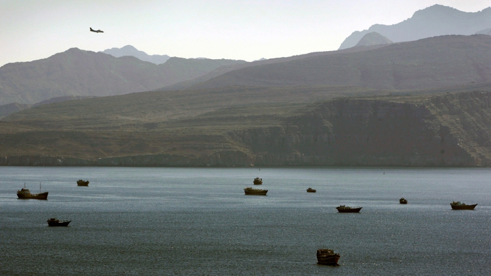 Trading dhows and ships in the Strait of Hormuz, on Jan. 19, 2012. (AP / Kamran Jebreili)
