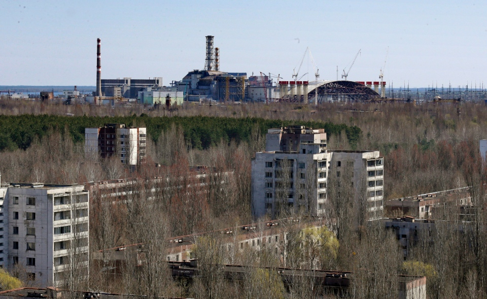 The town of Prypyat is seen against the background of the damaged reactor at the Chernobyl nuclear power plant in Prypyat, Ukraine, Tuesday, April 23, 2013. (AP / Efrem Lukatsky)