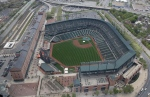 In this aerial photo, Oriole Park at Camden Yards sits empty in Baltimore on Tuesday, April 28, 2015. (AP Photo/Patrick Semansky)