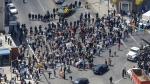Police stand in formation near a gathering of protestors at the intersection of North Avenue and Pennsylvania Avenue, Tuesday, April 28, 2015. (AP / Patrick Semansky)