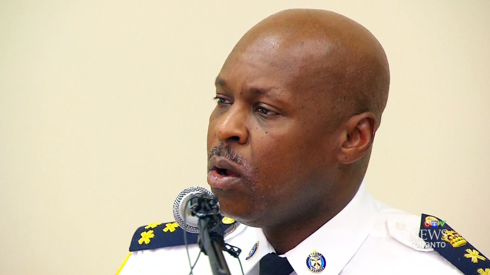 Police Chief Mark Saunders speaks with attendees at the African Canadian Summit on Tuesday, April 29, 2015.
