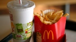 In this Tuesday, Jan. 21, 2014, photo, a large order of french fries and drink are photographed at a McDonald's restaurant in Robinson Township, Pa. (AP Photo/Gene J. Puskar)