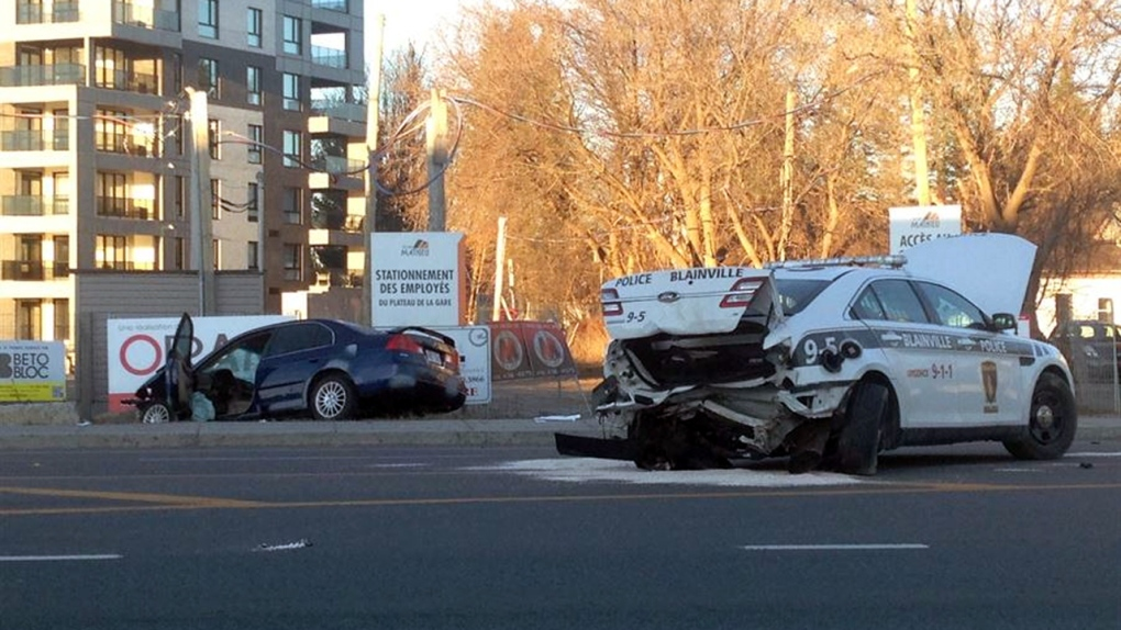 The damaged police car and other sedan