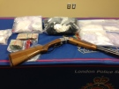 Police display the drugs, cash and weapons seized after a three-month drug investigation in London, Ont. on Thursday, April 30, 2015. (Nick Paparella / CTV London)