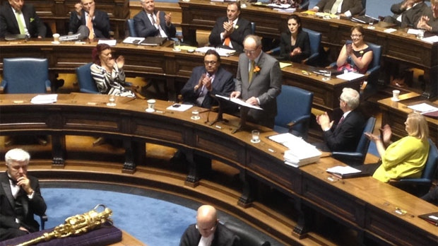 Manitoba Finance Minister Greg Dewar (at podium) presents the budget in the legislature on April 30, 2015. Dewar said this will not be the last budget before the next provincial election.