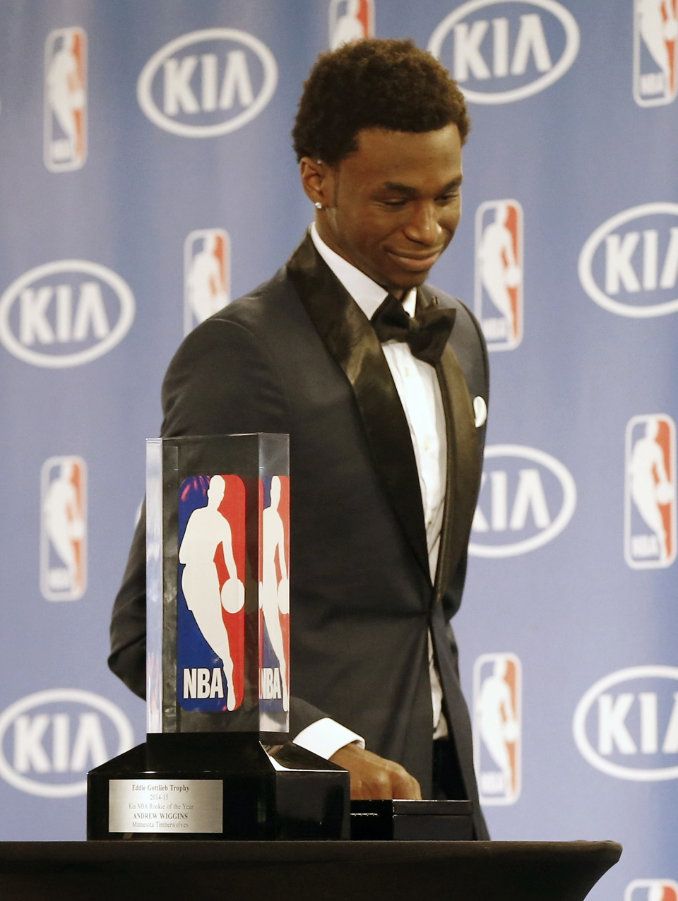 Minnesota Timberwolves' Andrew Wiggins smiles as he walks past his trophy during a news announcing he was the NBA basketball Rookie of the Year, in Minneapolis, Thursday, April 30, 2015. (AP / Jim Mone)