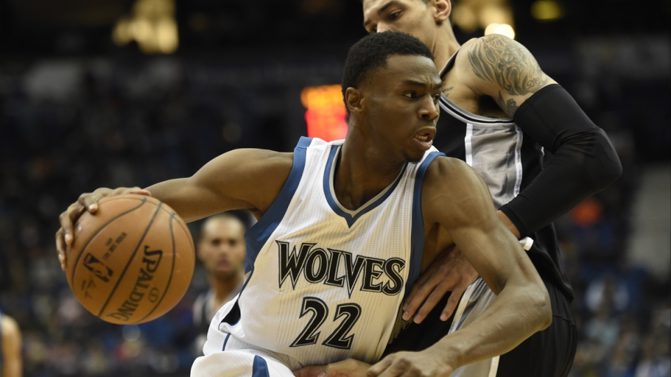 Minnesota Timberwolves forward Andrew Wiggins (22) drives against San Antonio Spurs guard Danny Green (14) during the fourth quarter of an NBA basketball game in Minneapolis, Jan. 10, 2015. (AP / Hannah Foslien)