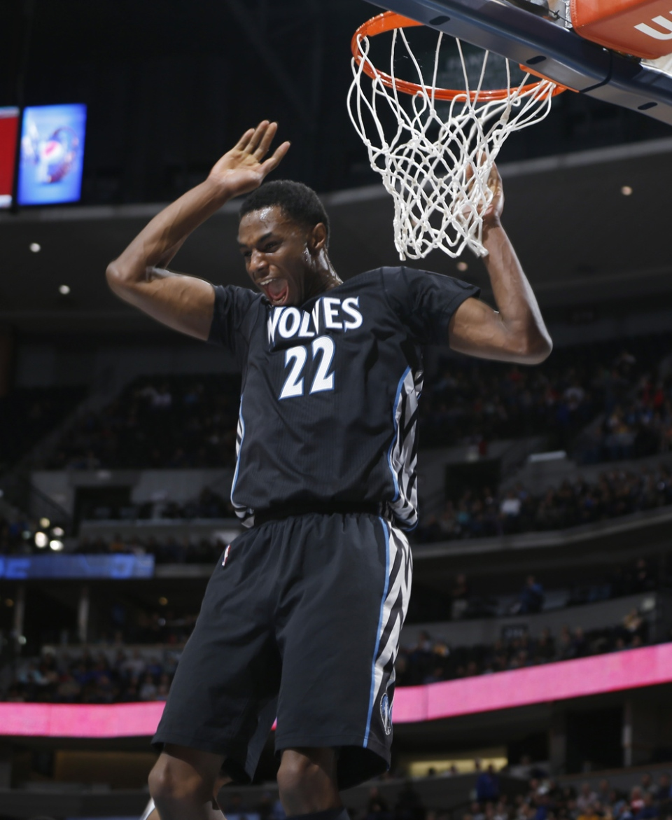 Minnesota Timberwolves forward Andrew Wiggins reacts after missing a pass for potential dunk against the Denver Nuggets in the first quarter of an NBA basketball game in Denver, Jan. 17, 2015. (AP / David Zalubowski)