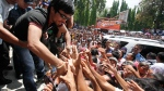 Manny Pacquiao greets supporters in Maasim, Sarangani province, Philippines, on March 26, 2010.  (AP / Bullit Marquez)