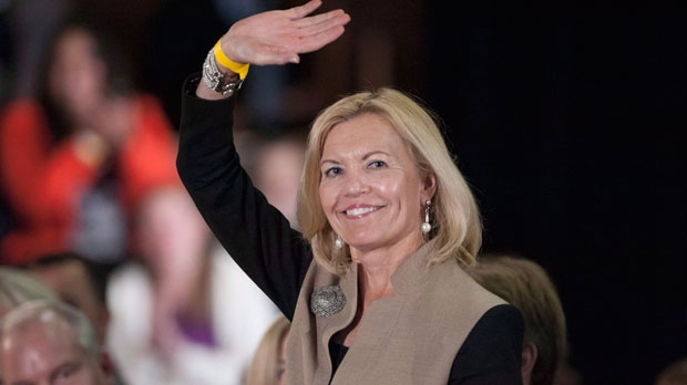 Christine Elliot, Member of Provincial Parliament for Whitby-Oshawa, waves at the audience during a Conservative members event in Oshawa, Ontario on Thursday, Oct. 9, 2014. THE CANADIAN PRESS/Hannah Yoon