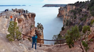 Visitors to Mather Point on the South Rim of Grand Canyon National Park, in Arizona, on Thursday, Dec. 11, 2014. (Michael Quinn / National Park Service)