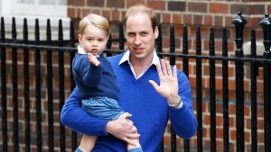 Prince William and his son Prince George wave as they return to St. Mary's Hospital's exclusive Lindo Wing, London, Saturday, May 2, 2015. (AP / Kirsty Wigglesworth)