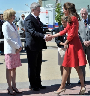 The Duchess of Cambridge is greeted by Prime Minister Stephen Harper and his wife Laureen (left) and Lt.-Gov. David Johnston and his wife Sharon (behind right) at the official departure ceremony in Calgary, July 8, 2011. Harper congratulated the duchess on the birth of her daughter on May 2, 2015. (THE CANADIAN PRESS/Nathan Denette)