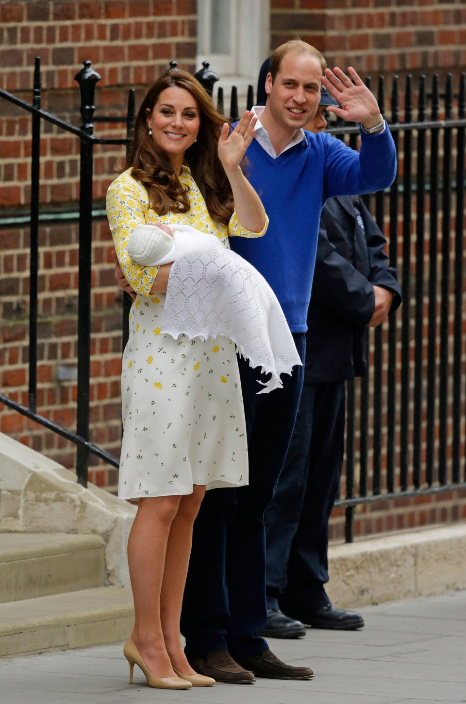 Prince William and Kate, Duchess of Cambridge and their newborn baby princess, pose for the media as they leave St. Mary's Hospital's exclusive Lindo Wing, London, Saturday, May 2, 2015. (AP / Matt Dunham)
