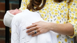 Kate, Duchess of Cambridge holds her newborn baby princess,as she poses for the media as she leaves St. Mary's Hospital's exclusive Lindo Wing, London, Saturday, May 2, 2015. (AP / Kirsty Wigglesworth)