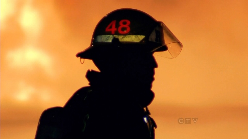 A firefighter is shown against a backdrop of flames in this undated file photo. (CTV News)