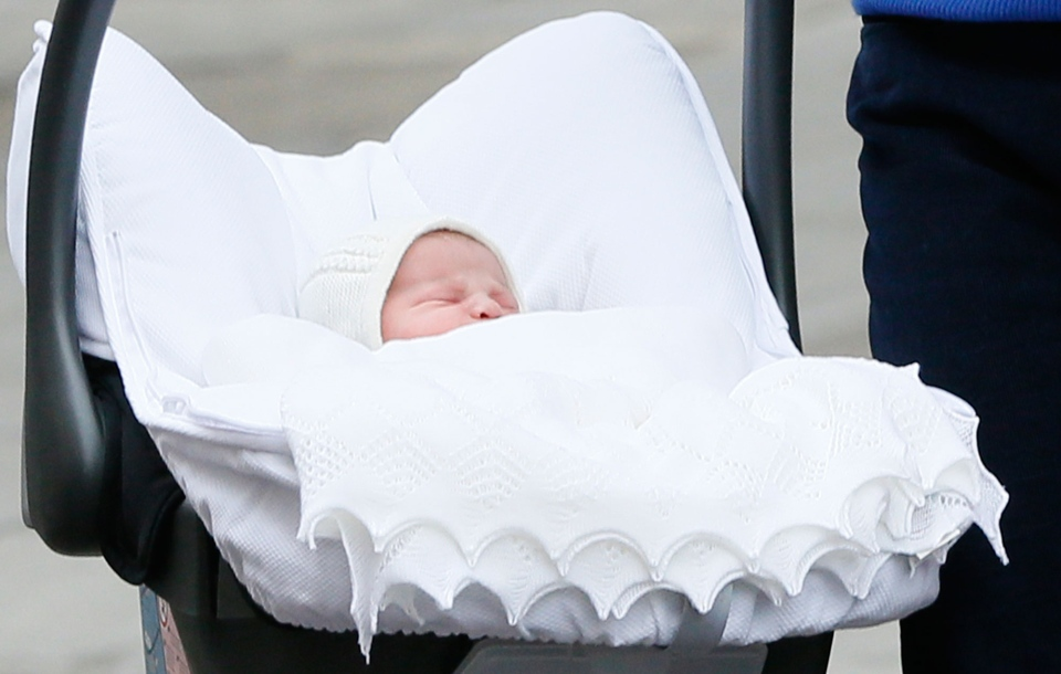 Britain's Prince William and Kate, Duchess of Cambridge, hold their newborn daughter as they as they pose for the media outside St. Mary's Hospital's exclusive Lindo Wing, London, Saturday, May 2, 2015. (AP / Kirsty Wigglesworth)