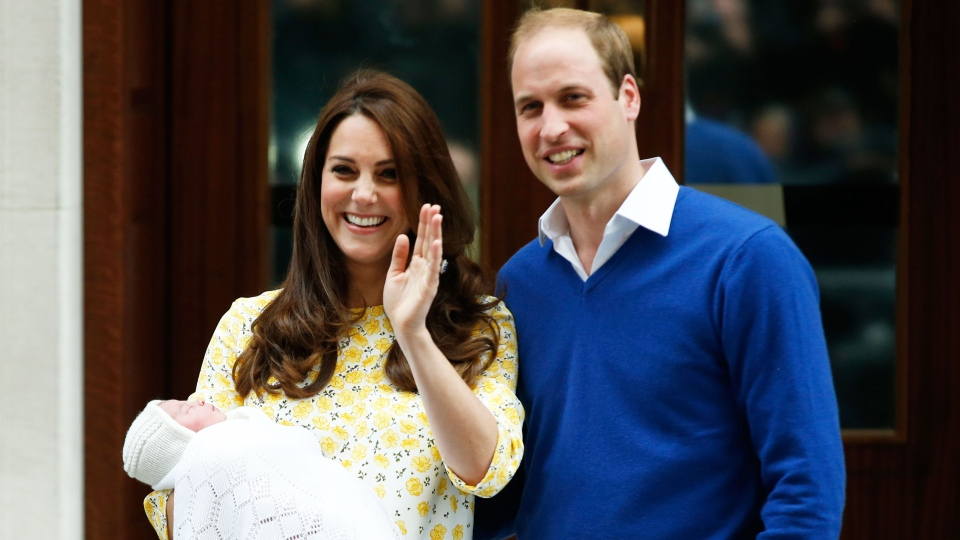 Prince William and Kate, Duchess of Cambridge, pose for the media with their newborn daughter outside St. Mary's Hospital's exclusive Lindo Wing, London, Saturday, May 2, 2015. (AP / Alastair Grant)