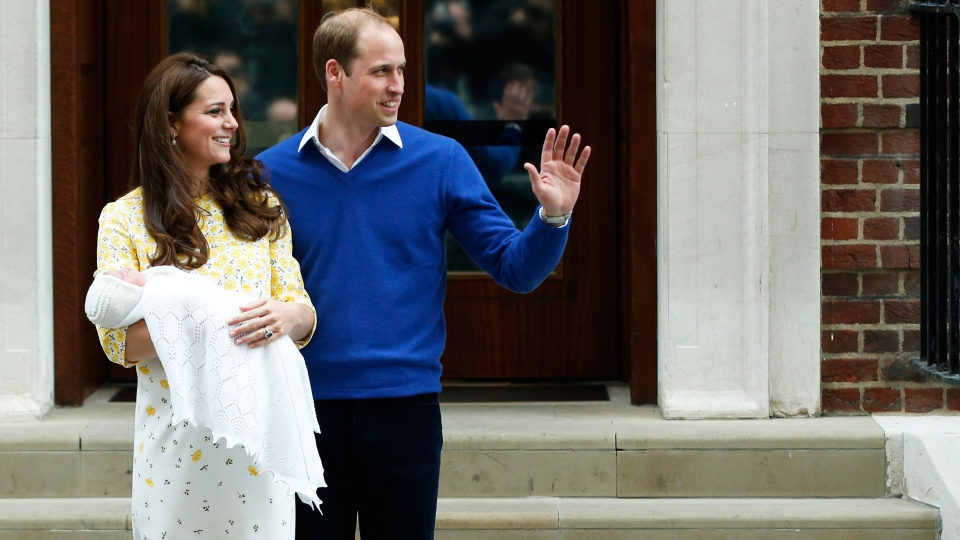 Prince William, right, and Kate, Duchess of Cambridge, pose for the media with their newborn daughter outside St. Mary's Hospital's exclusive Lindo Wing, London, Saturday, May 2, 2015. (AP / Alastair Grant)