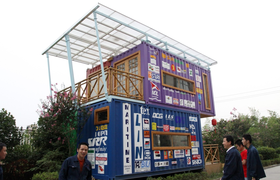 Photo shows a house made from 4 shipping containers on August 29, 2013 in Jiaxing, Zhejiang Province of China. Developers in Canada are planning to repurpose shipping containers to build homes in communities across Canada. (Photo by Hu Lingxiang/ChinaFotoPress)