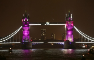 Tower Bridge is lit up to celebrate the Duke and Duchess of Cambridge's newborn baby, in London, Saturday May 2, 2015. (AP / PA / Yui Mok)