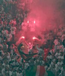 Polish fans hold flares