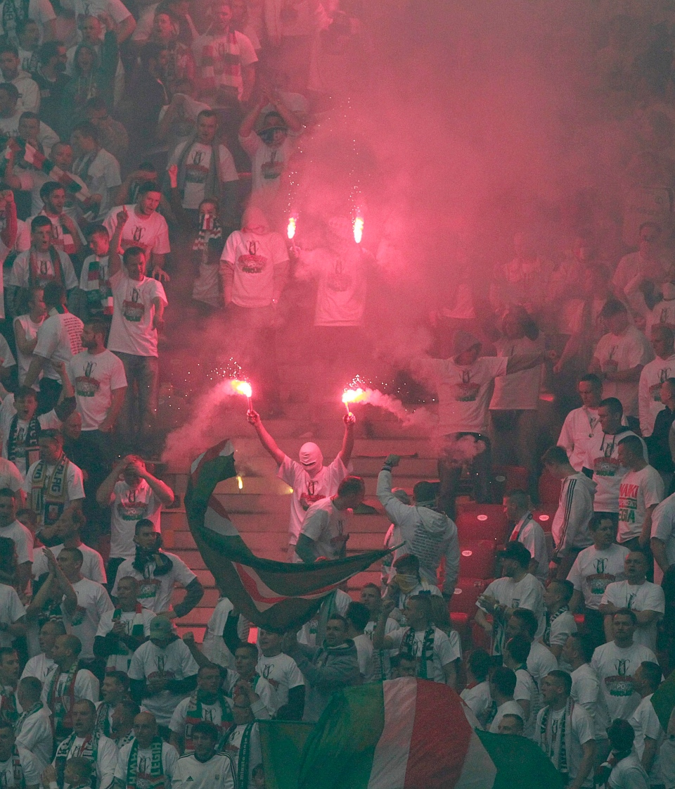 Polish fans hold flares during the final match of the Poland Cup between Legia Warszawa and Lech Poznan at National Stadium in Warsaw, Poland, Saturday, May 2, 2015. (AP / Czarek Sokolowski)