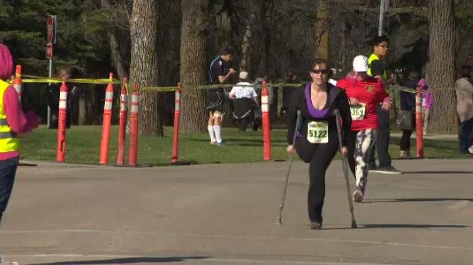 Sandi Reimer finishes the WPS 5 km race at Assiniboine Park May 3, 2015.
