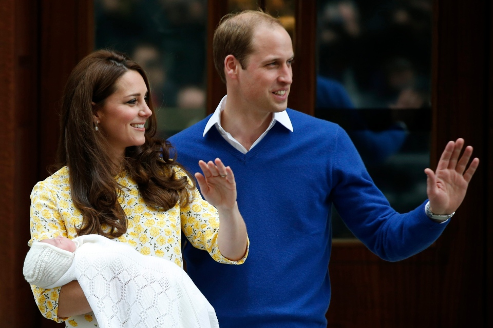 Prince William and Kate, Duchess of Cambridge, pose for the media with their newborn daughter outside St. Mary's Hospital's exclusive Lindo Wing, London on May 2, 2015. (AP / Alastair Grant)