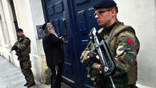 French soldiers guard a Jewish school