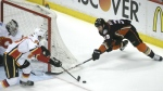 Anaheim Ducks' Matt Beleskey, right, is defended by Calgary Flames' Sam Bennett during the first period of Game 2 in the second round of the NHL Stanley Cup hockey playoffs in Anaheim, Calif. on May 3, 2015. (AP / Jae C. Hong)
