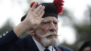Canadian Second World War veteran Sandy Sanderson, 88, of Niagara Falls, Ont., pays tribute to Canada's war dead at the Holten Canadian War Cemetery, near Arnhem, Netherlands, on Monday, May 4, 2015. (Sean Kilpatrick / THE CANADIAN PRESS)