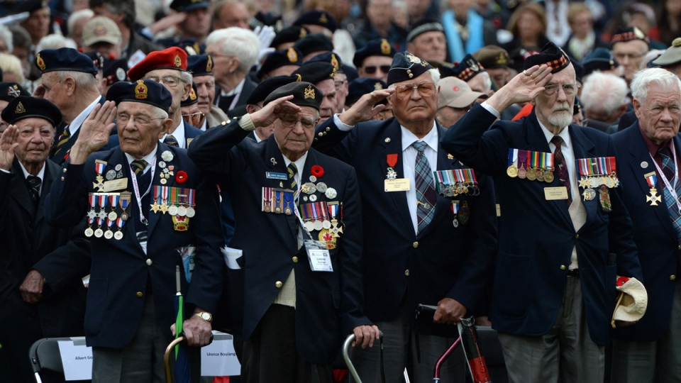 Canadian Second World War veterans take part in a commemorative ceremony at Holten Canadian War Cemetery in Holten, Netherlands on Monday, May 4, 2015. (Sean Kilpatrick / THE CANADIAN PRESS)