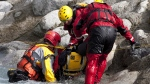 Emergency responders pull a dummy onto the shore after rescuing it from a sunken car during a training exercise in Pemberton, B.C., Wednesday, Sept. 26, 2012. (Jonathan Hayward / THE CANADIAN PRESS)