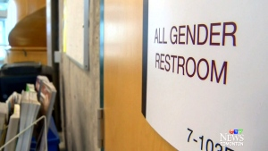 An all-gender bathroom sign is shown in Edmonton, Alta.