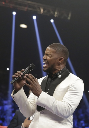 Actor Jamie Foxx sings the U.S. national anthem before the start of the world welterweight championship bout between Floyd Mayweather Jr., and Manny Pacquiao, on Saturday, May 2, 2015 in Las Vegas. (AP Photo / Isaac Brekken)