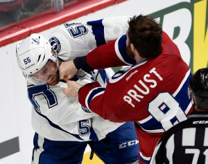 Montreal Canadiens winger Brandon Prust (8) fights with Tampa Bay Lightning defenceman Braydon Coburn (55) during third period of Game 2 NHL second round playoff hockey action on May 3, 2015 in Montreal.(Ryan Remiorz / The Canadian Press)