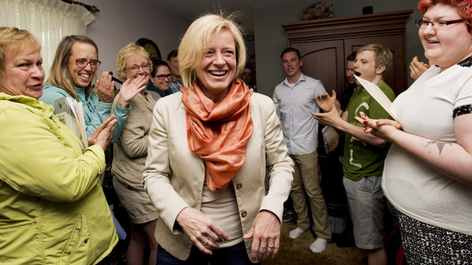 Alberta NDP leader Rachel Notley, centre, is greeted by volunteers and supporters at a NDP campaign event in Edmonton on Tuesday, May 5, 2015. (Nathan Denette / THE CANADIAN PRESS)
