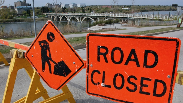A 'Road Closed' sign sits along Saskatchewan Crescent East, near the top of the University Bridge. The bridge is closed until the end of August.