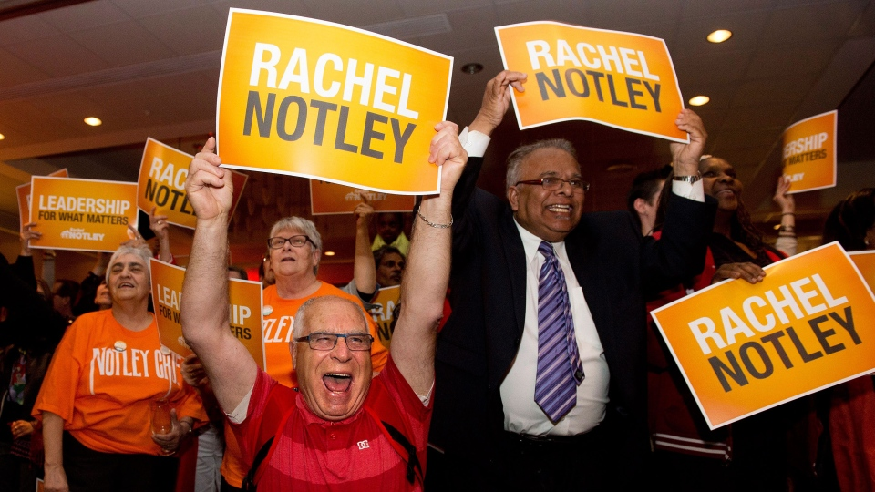 NDP supporters react as they watch the results at NDP leader Rachel Notley's headquarters in Edmonton on Tuesday, May 5, 2015. (Nathan Denette / THE CANADIAN PRESS)