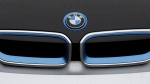 The logo of German car manufacturer BMW is pictured on a BMW i3 electric drive car at the production line in Dingolfing, Germany on Jan. 20, 2015. (AP / Matthias Schrader)