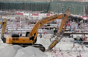 In this photo taken during a government organized media tour, workers use heavy machinery at the Al-Wakra Stadium being built for the 2022 World Cup, in Doha, Qatar on May 4, 2015. (Maya Alleruzzo / AP Photo)