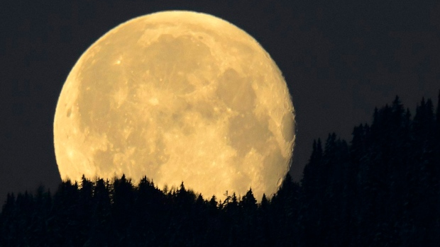 The moon sets in Charrat, Switzerland, on Monday, April 6, 2015. (AP Photo/Keystone,Laurent Gillieron)